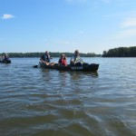Journalists canoe with scientists